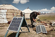 Nemat Ullah, son of Abdul Walli..Installing solar panels that charge car batteries to provide electricty, mainly for light bulbs and 2 way radios...Daily life at the Khan (chief) summer camp of Kara Jylga...Trekking through the high altitude plateau of the Little Pamir mountains (average 4200 meters) , where the Afghan Kyrgyz community live all year, on the borders of China, Tajikistan and Pakistan.