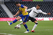 Derby County defender Jayden Bogle wins the ball from Southampton forward Shane Long during the The FA Cup 3rd round match between Derby County and Southampton at the Pride Park, Derby, England on 5 January 2019.
