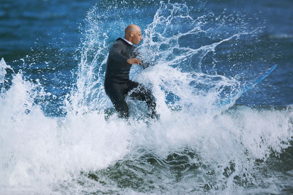A surfer at Lyall Bay, Wellington, New Zealand.