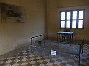 A metal bed used to torture inmates using electricity.<br /> The Toui Sleng Genocide Museum. The Toui Sleng was a college turned into interrogation and torture centre by the Khmer Rouge during their rule in the seventies, called S21 by the Khmer Rouge. Most inmates were murdere, either they died during torture or in the Klling Fields outside Phnom Penh. An estimated 17,000 prisoners were held at the prison, called S21 by the Khmer Rouge and only 7 is believed to have survived imprissonment, the rest died either in prison or were killed in the Killing Fields. <br /> The Toui Sleng prison was run by Kang Kek Iew, Comrade Duch, a former school teacher. On 26 July 2010, Duch was found guilty of crimes against humanity, torture, and murder; he was sentenced to 35 years' imprisonment