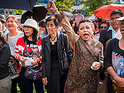 19 SEPTEMBER 2015 - BANGKOK, THAILAND:  Anti-coup protestors at Thammasat University. Hundreds of people protested against Thailand's military dominated government Saturday. The protest started with seminar about the 2006 coup that deposed popularly elected former Prime Minister Thaksin Shinawatra. After the seminar activists marched from Thammasat University to Democracy Monument, about 1 mile. Political gatherings of more than 5 people are banned by Thailand's military government and police tried to dissuade the protestors from finishing their march. Protestors ignored the police, who then stood by and watched but made no effort to intervene. At Democracy Monument protestors laid flowers and made speeches against the military. It was the largest anti-coup protest in Bangkok in more than a year.    PHOTO BY JACK KURTZ