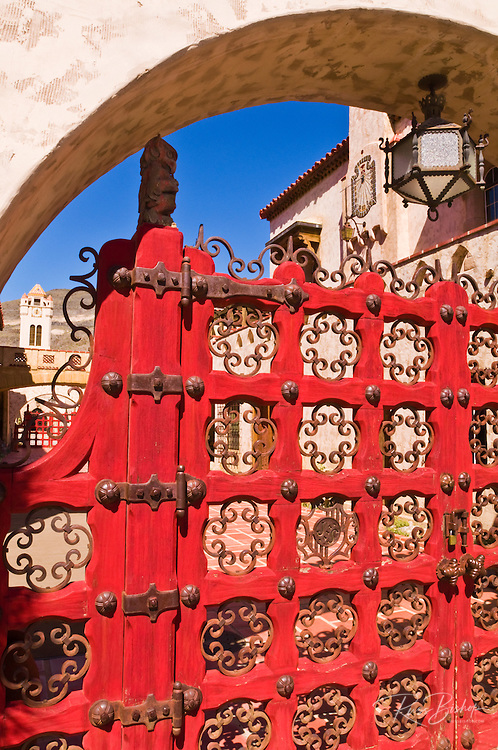 Red gate and clock tower at Scottys Castle, Death Valley National Park. California