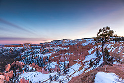 Bryce Canyon Winter Sunset. Bryce National Park is a world away from reality, hodoos, twisted trees, pinnacles of red, white and pink. Where the psychedelia of the Colorado Plateau meets the sky at the top of the Rocky Mountains.   This place is amazing.