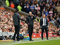 Football - 2019 / 2020 Premier League - Liverpool vs. Leicester City<br /> <br /> Managers Jurgen Klopp of Liverpool and Brendan Rodgers of Leicester City with fourth official Mike Dean, at Anfield.<br /> <br /> COLORSPORT/ALAN MARTIN