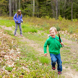 A young boy and girl explore the trails in the Stonehouse Forest in Barrington, New Hampshire.