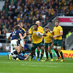 LONDON, ENGLAND - OCTOBER 18: Tevita Kuridrani of Australia looks to hand off Peter Horne of Scotland during the Rugby World Cup Quarter Final match between Australia v Scotland at Twickenham Stadium on October 18, 2015 in London, England. (Photo by Steve Haag)