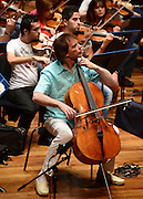 © Licensed to London News Pictures. 28/08/2012. London, UK JULIAN LLOYD WEBBER (green shirt) The Youth Orchestra of Iraq, set up by a 17-year-old girl in Baghdad with musicians recruited through YouTube in rehearsal for its London debut at the Queen Elizabeth Hall, Southbank Centre London on Tuesday 28 August. with cellist Julian Lloyd Webber today 28 August 2012. Photo credit : Stephen Simpson/LNP