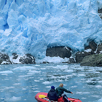CORDILLERA SARMIENTO EXPED., Jack Miller & Philip Lloyd (MR) raft in Chile's Fjord of the Mountains, below calving glacier face.