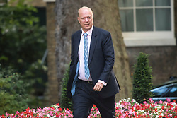 © Licensed to London News Pictures. 12/09/2017. London, UK. Secretary of State for Transport CHRIS GRAYLING arrives at 10 Downing Street in London ahead of a cabinet meeting.  In the early hours of this morning government won a vote in Commons passing the EU repeal bill, by a margin of 326 to 290 votes. Photo credit: Ben Cawthra/LNP