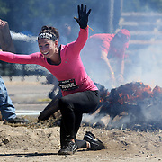 Jessica Pierno in action at the fire jump obstacle during the Reebok Spartan Race. Mohegan Sun, Uncasville, Connecticut, USA. 28th June 2014. Photo Tim Clayton