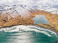Aerial view of turquoise bay and lagoon in Dutch Harbor, Alaska, USA.
