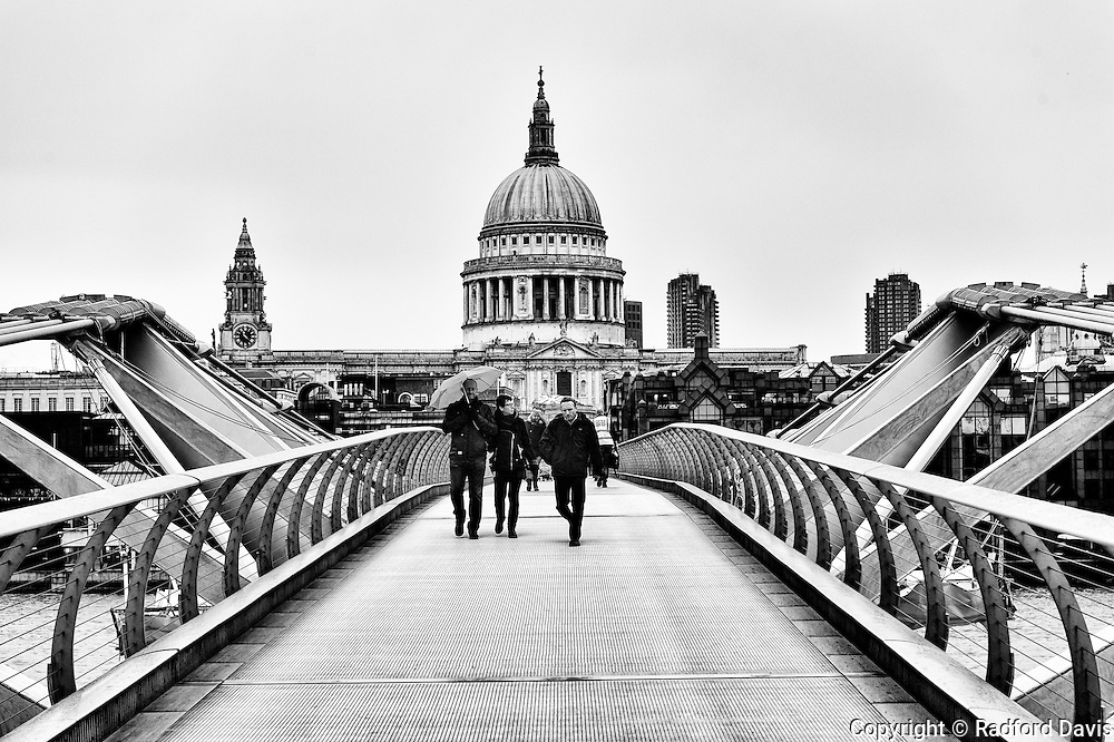 Millennium Bridge and St. Paul's Cathedral in the background, London. Black and white.