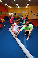 Jim Lark works with students at The Little Gym in Brentwood on Saturday, May 19, 2012.  (Photo by Kevin Bartram)
