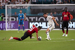 July 31, 2018 - Miami Gardens, Florida, USA - Manchester United F.C. midfielder Andreas Pereira (15) (left) fall as he fights for the ball with Real Madrid C.F. forward Borja Mayoral (21) (right) during an International Champions Cup match between Real Madrid C.F. and Manchester United F.C. at the Hard Rock Stadium in Miami Gardens, Florida. Manchester United F.C. won the game 2-1. (Credit Image: © Mario Houben via ZUMA Wire)