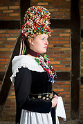 Celine, member of the 'Original Scheeßeler Trachtengruppe e.V.' is wearing an original traditional bridal costume in Scheeßel, Lower Saxony, Germany on November 13, 2016.<br /> <br /> The jewelry and crown is from the time between 1830 and 1870.<br /> Only pristine women were allowed to wear the bridal crown.<br /> <br /> This is part of the series about Traditional Wedding Gowns from different regions of Germany, worn by young members of local dance groups and cultural associations that exist to preserve and celebrate the cultural heritage. The portraiture series is a depiction of an old era with different social values and religious beliefs in an antiquated civil society with very few of those dresses left.