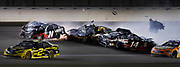 William Byron (24) Ryan Newman (31) and Clint Bowyer (14 ) wreck near turn four as Brad Keselowski (2 ) narrowly misses misses during a NASCAR Cup Series auto race at Kansas Speedway in Kansas City, Kan., Saturday, May 12, 2018. (AP Photo/Colin E. Braley)