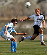 NEWS&GUIDE PHOTO / PRICE CHAMBERS<br /> Jackson senior Daniel Maurais heads the ball over a Cheyenne East defender Saturday in Green River at the regional tournament. Jackson clinched a spot at the state tournament next weekend in Laramie after winning the game 2-1. Later that day Jackson lost to Cheyenne Central 2-1.