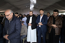 © Licensed to London News Pictures . 12/05/2017 . Manchester , UK . Prospective Parliamentary Candidate for Gorton , AFZAL KHAN (2nd from right) at the service . Thousands of people fill a mosque , inside a marquee at the British Muslim Heritage Centre in Whalley Range , Manchester , for the funeral of Mawlana Habib-ur-Rahman , at the British Muslim Heritage Centre , Whalley Range , Manchester . Rahman , a former maths teacher and then imam at Manchester Central Mosque , died aged 90 following heart problems . As a well-known leader of Manchester's Muslim community he promoted interfaith dialogue and met the Pope during a Papal visit to Manchester in 1982 . Due to the number attending , crowds attending the funeral had to be diverted to rooms in nearby buildings to listen to the service via loudspeaker . Photo credit : Joel Goodman/LNP