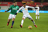 Martin Olsson of Swansea city holds off Hal Robson-Kanu of West Bromwich Albion. Premier league match, Swansea city v West Bromwich Albion at the Liberty Stadium in Swansea, South Wales on Saturday 9th December 2017.<br /> pic by  Andrew Orchard, Andrew Orchard sports photography.