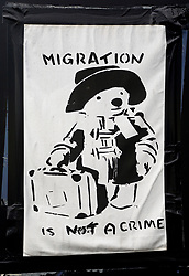 30 July 2021. Calais, France.<br /> Immigration is not a Crime. A sign on the door at British founded charity Care4Calais load a van as they prepare to head out offering assistance in the form of food, phone charging, tents, blankets, tarpaulins and other vitally needed services to migrant refugees in Calais. With police ramping up efforts to make Calais as hostile as possible, it has become increasingly difficult for charities to help migrants, many of whom have taken to living in swampy inhospitable terrain spread around the town. <br /> Photo©; Charlie Varley/varleypix.com
