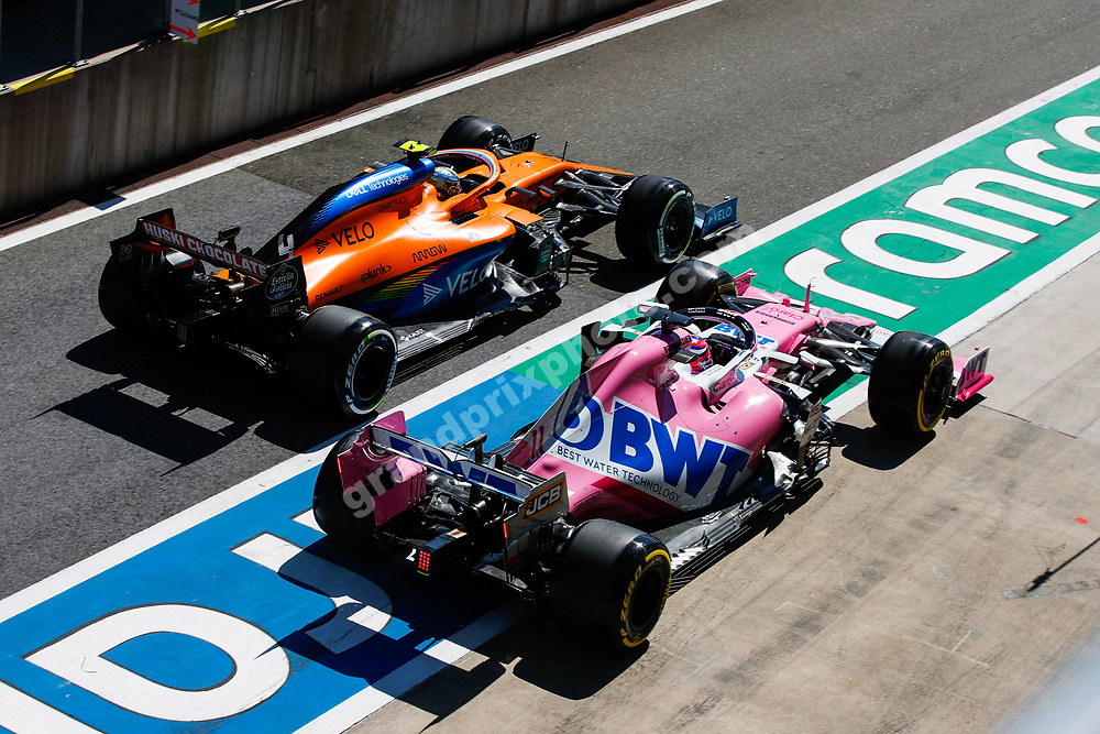 Lando Norris (McLaren-Renault) and Sergio Perez in a close duel in the pitlane during the 2020 Austrian Grand Prix at the Red Bull Ring in Spielberg.  © Copyright: FIA Pool Image for Editorial Use Only