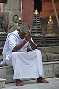 Holy man praying at the Mahabodhi Temple, Bodhgaya, Bihar, India