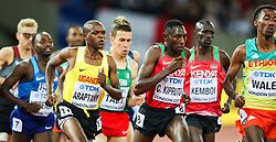 London, August 08 2017 . Eventual winner Conseslus Kipruto, Kenya, powers his way through the pack in the men's 3,000m steeplechase final on day five of the IAAF London 2017 world Championships at the London Stadium. © Paul Davey.
