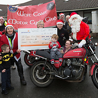 Members of the West Coast Motorcycle Club present a cheque for 1620.00 to Moira Lawler Principle of St Clare's School and John Costelloe Board Chairman St Clare's School