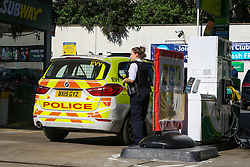 © Licensed to London News Pictures. 03/10/2021. London, UK. A police officer fills her car with diesel at a BP petrol station in north London as the fuel crisis continues. From tomorrow (4 October) military personnel, including 100 drivers, will start fuel deliveries. Photo credit: Dinendra Haria/LNP