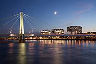 the Severins bridge across the river Rhine, in the background the harbor Rheinauhafen with the Crane Houses, Cologne, Germany.<br /> <br /> die Severinsbruecke ueber den Rhein, im Hintergrund der Rheinauhafen mit den Kranhaeusern, Koeln, Deutschland.