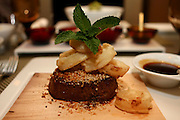 Grilled steak on wooden platter with potato