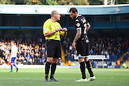 Chris McCann of Wigan Athletic receives a yellow card from referee Graham Salisbury. Skybet football league one match , Bury v Wigan Athletic at the JD Stadium in Bury, Lancs on Saturday 10th October 2015.<br /> pic by Chris Stading, Andrew Orchard sports photography.