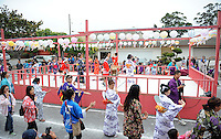 """Costumed dancers, friends and family move counter-clockwise around the central stage during the """"bon odori"""" dances at the end of Sunday's 63rd annual Obon Festival at the Buddhist Temple of Salinas."""