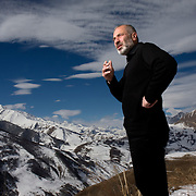Portrait of Vitali Kaloyev on the Caucasian mountains near his hometown of Vladikavkaz, in North Ossetia in southern Russia. .The 52-year-old architect, who killed the air traffic controller blamed for the plane crash in which he lost his wife and two children, is being treated as a national hero..Kaloyev, who was freed November 2007 from a Swiss jail after serving less than four years, was appointed deputy construction minister for his home region..Kaloyev was building a holiday villa in Spain for a wealthy Russian when his wife Svetlana, 44, 10-year-old son Konstantin and four-year-old daughter Diana, set out to join him for a holiday in July 2002. As their plane flew over Germany it collided with a cargo jet killing all 71 people on board, most of them Russian schoolchildren..Investigators later established that Peter Nielsen, a Dane working for Skyguide, the Swiss air-traffic control service at Zurich airport, was the only person on duty. He had panicked when he realised the two planes were on a collision course and gave wrong instructions to the pilots..Like other bereaved relatives, Kaloyev grew angry at the slow pace of the investigation and the way Skyguide, fearful of lawsuits, sought to place the blame on others..Kaloyev claims he cannot remember what happened next, but does not deny stabbing Nielsen several times with a pocket knife. Nielsen bled to death before an ambulance could reach him. Kaloyev was arrested the following day and was sentenced to eight years for manslaughter.