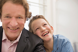 Portrait of father in suit with son