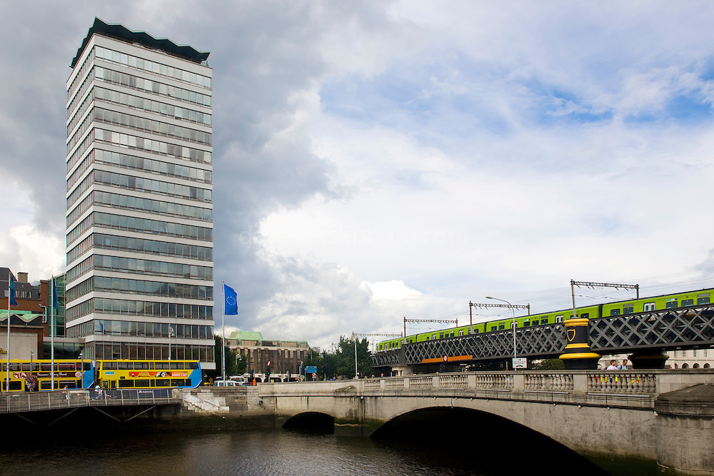 As of August 2008, Liberty Hall is still the tallest storyed building in Dublin - at just 59m, that's quite remarkable. The 16-floor headquarters of the Services, Industrial, Professional, and Technical Union (SIPTU) was designed by Desmond Rea O'Kelly and built on Eden Quay between 1961 and 1965, and is slated for demolition in 2009.....Liberty Hall was built on the site of an earlier building of the same name that became a rebel stronghold during the 1916 rising. It was in bad shape after being shelled by British troops, but was rebuilt. However, it was found to be structurally unsound in the 1950s and replaced with the current skyscraper, as the headquarter of what was then the Irish Transport and General Workers Union (ITGWU)....Dart and Dublin buses also in the photograph.
