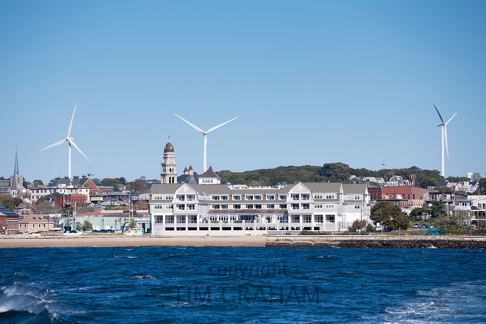 Beauport Hotel with sweeping waterfront ocean views and wind turbines behind in Gloucester, Massachusetts, New England, USA