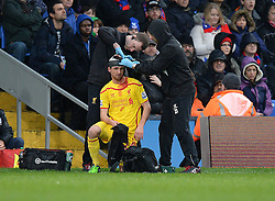 Liverpool's Joe Allen has his head bandage up with blood on his shirt. - Photo mandatory by-line: Alex James/JMP - Mobile: 07966 386802 - 23/11/2014 - Sport - Football - London -  - Crystal palace  v Liverpool - Barclays Premier League