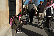 Girl with pink headphones and rucksack listening to music in a multicultural scene in Whitechapel in London, England, United Kingdom. (photo by Mike Kemp/In Pictures via Getty Images)