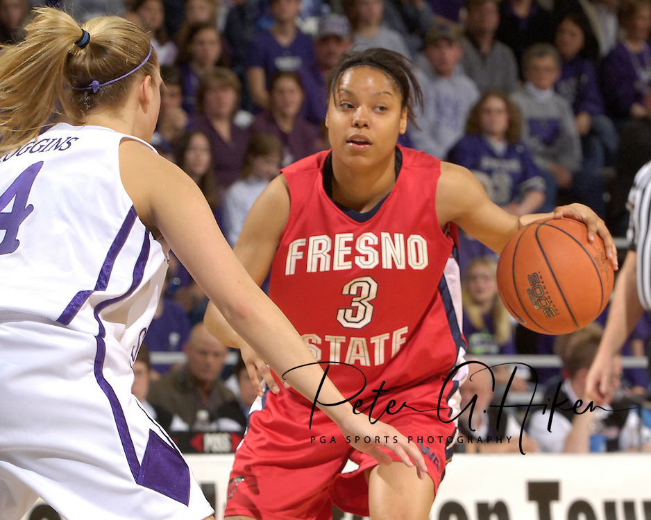 Fresno State guard Tierre Wilson (3) looks for room to drive against pressure from Kansas State's Claire Coggins (L), during the first half at Bramlage Coliseum in Manhattan, Kansas, March 22, 2006.  K-State defeated the Bulldogs 64-61 in the second round of the WNIT.