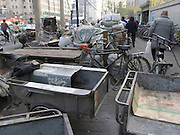parked bicycle carts waiting Beijing China