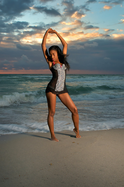 A young multi-racial girl practices yoga and relaxes in the morning.
