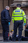 Extinction Rebellion activist, co-founder and spokesperson Robin Boardman who glued themselves in front of the Peers Gate, outside Westminster Palace of the Houses of Parliament, is being removed by the Protest Removal Police team and expects to be taken by the Police, Thursday, Sept 3, 2020. Environmental nonviolent activists group Extinction Rebellion enters its 3rd day of continuous ten days to disrupt political institutions throughout peaceful actions swarming central London into a standoff, demanding that central government obeys and delivers Climate Emergency bill.