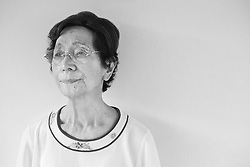 Black and white portrait photograph of Far East Asia old grandmother dealing with heavy depression