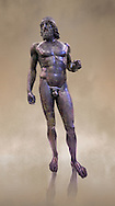 low full length view of the  Riace bronze Greek statue A cast about 460 BC. statue A was probably sculpted by Myron. The style of the Riace statues straddles the archaic period and heralds the start of the classical period. Both statues depict strong young naked warriors who stand calmly but exuding great power. Museo Nazionale della Magna Grecia,  Reggio Calabria, Italy.  .<br /> <br /> If you prefer to buy from our ALAMY STOCK LIBRARY page at https://www.alamy.com/portfolio/paul-williams-funkystock/greco-roman-sculptures.html . Type -    Riace     - into LOWER SEARCH WITHIN GALLERY box - Refine search by adding a background colour,  etc.<br /> <br /> Visit our ROMAN WORLD PHOTO COLLECTIONS for more photos to download or buy as wall art prints https://funkystock.photoshelter.com/gallery-collection/The-Romans-Art-Artefacts-Antiquities-Historic-Sites-Pictures-Images/C0000r2uLJJo9_s0