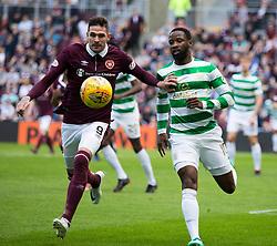 Celtic's Moussa Dembele (right) and Hearts Kyle Laferty (left) during the Ladbrokes Scottish Premiership match at Tynecastle Stadium, Edinburgh.