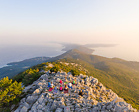 Aerial view of group practicing yoga at top of mountain, Veli Lošinj, Croatia.
