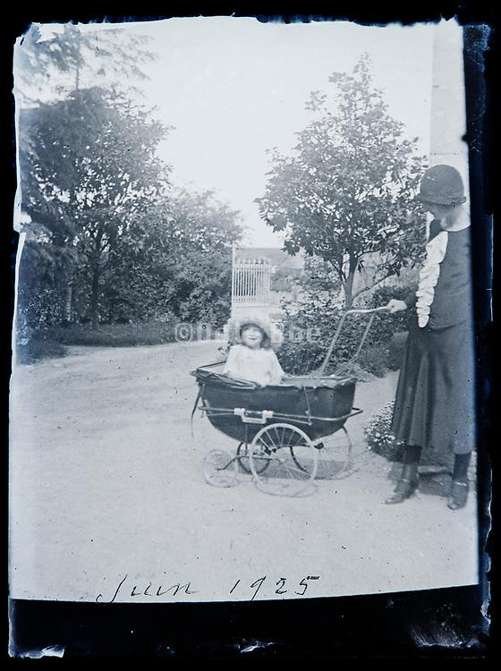 big toddler in a baby stroller France 1925