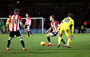 Brentford midfielder Sam Saunders setting up an attack during the Sky Bet Championship match between Brentford and Middlesbrough at Griffin Park, London, England on 12 January 2016. Photo by Matthew Redman.