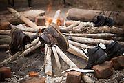 Shoes drying beside camp fire, Lekoli Bai.